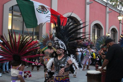 A Native American group performing a cultural dance. Photography by: Amber Juarez.