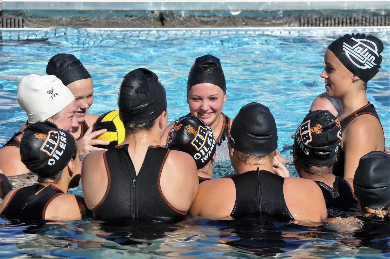 Last season's JV girls preparing for a game. Photo by: Tatiana Gasparre