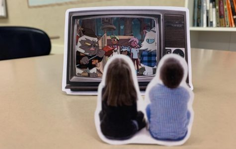 Image cut-out of two children watching a cartoon on a television.