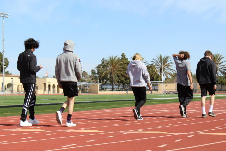 P.E.+students+walking+the+track.