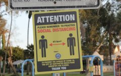 Social distancing sign at Lake Park, Huntington Beach, CA.