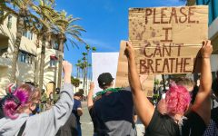 Black Lives Matter protesters in Huntington Beach standing up to police. Photography by: Amber Juarez.