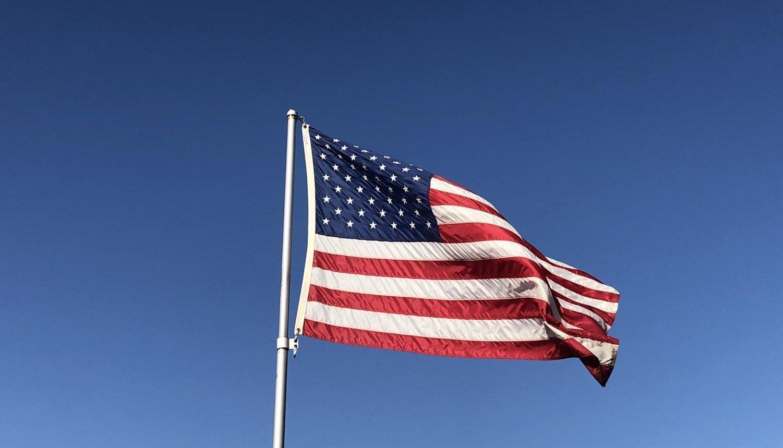 An American flag, photographed in Huntington Beach, CA. Photography by: Sarah Hart.