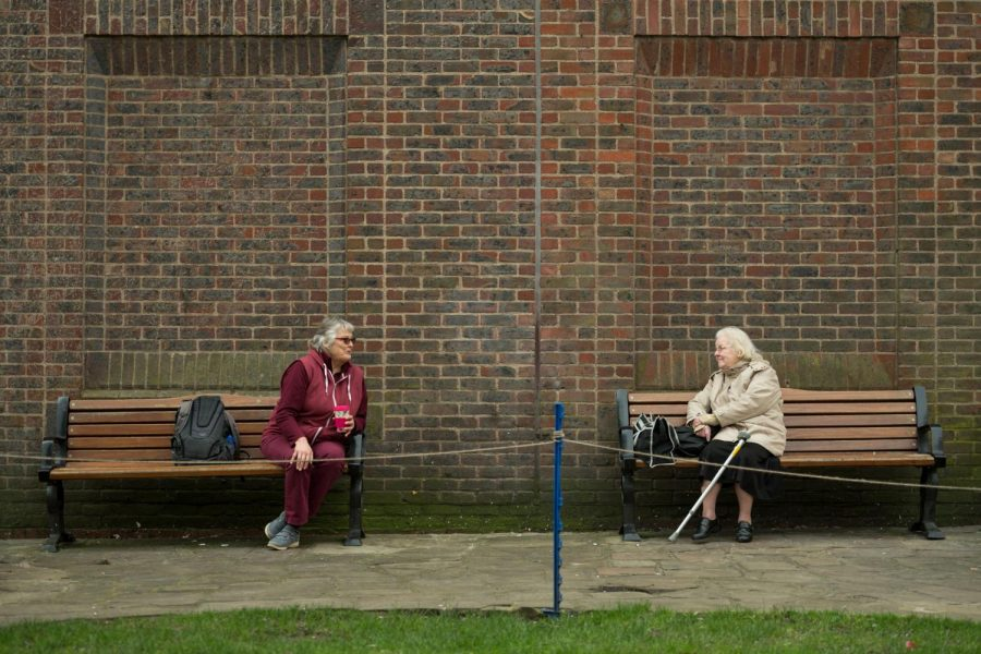 Two women observe social distancing measures as they speak to each other from adjacent park benches amidst the novel coronavirus COVID-19 pandemic, in the centre of York, northern England on March 19, 2020. Photography from: WORLD-NEWS-SOCIAL-DISTANCING-GET. Tribune Content Agency LLC, Chicago, 2020. eLibrary, https://explore.proquest.com/elibrary/document/2379436534?accountid=193113.