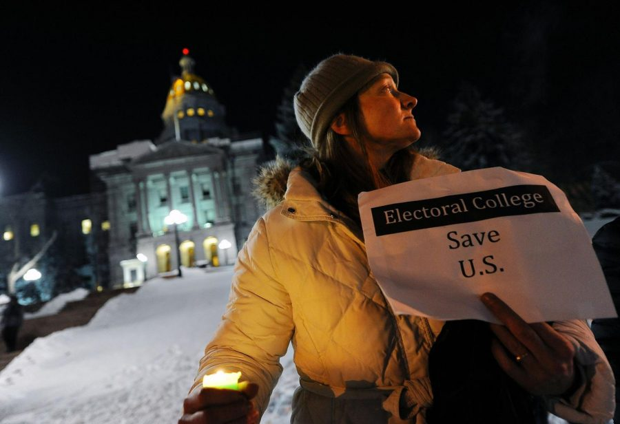 Woman participating in a candlelight vigil against possible President-elect Donald Trump and the misrepresentation of the electoral college in 2016. US-NEWS-ELECTORAL-COLLEGE-FACTS-15-GET. Tribune Content Agency LLC, Chicago, 2020. eLibrary, https://explore.proquest.com/elibrary/document/2449354728?accountid=193113.